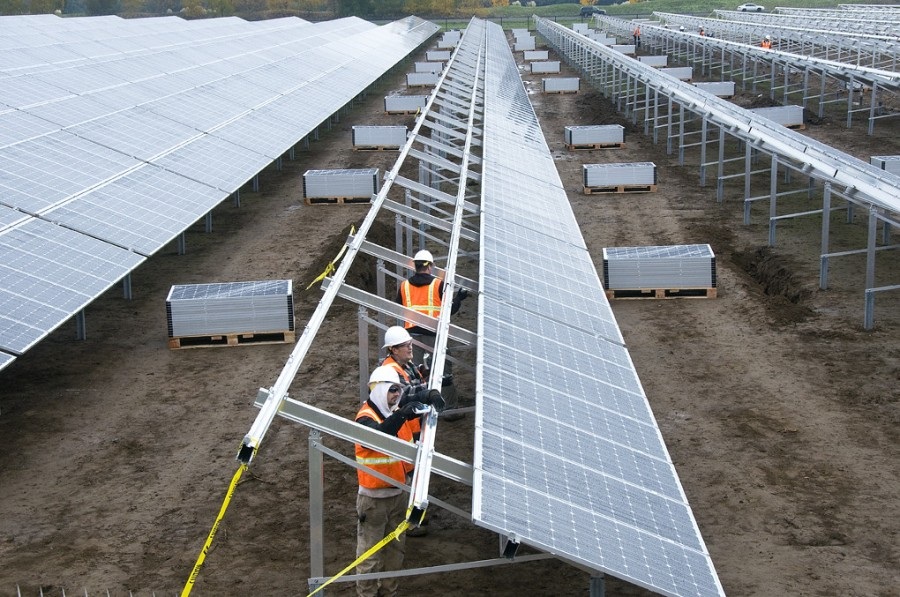 Installing solar panels. Photo: OregonDOT, licensed under CC BY 2.0.